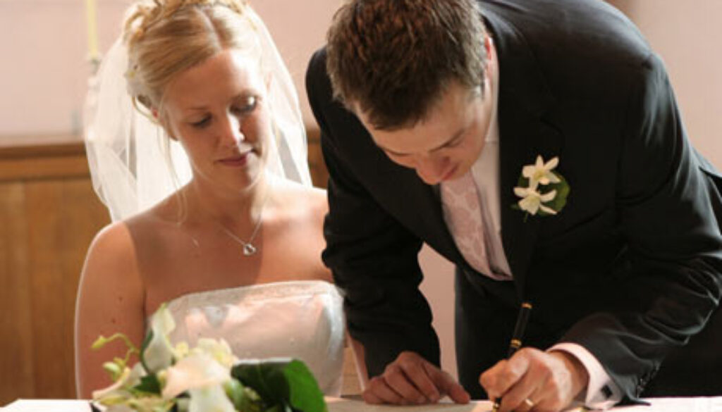 Bride-and-groom-signing-document-460x300.jpg