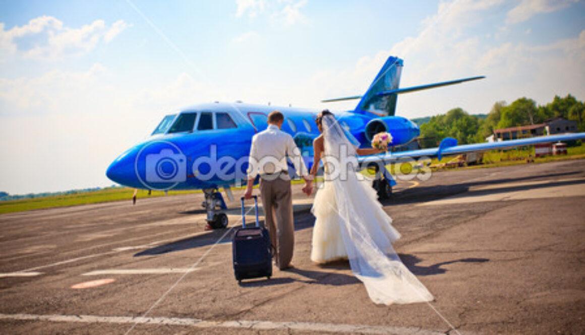 depositphotos_6056056-Wedding-couple-fly-on-honeymoon.jpg