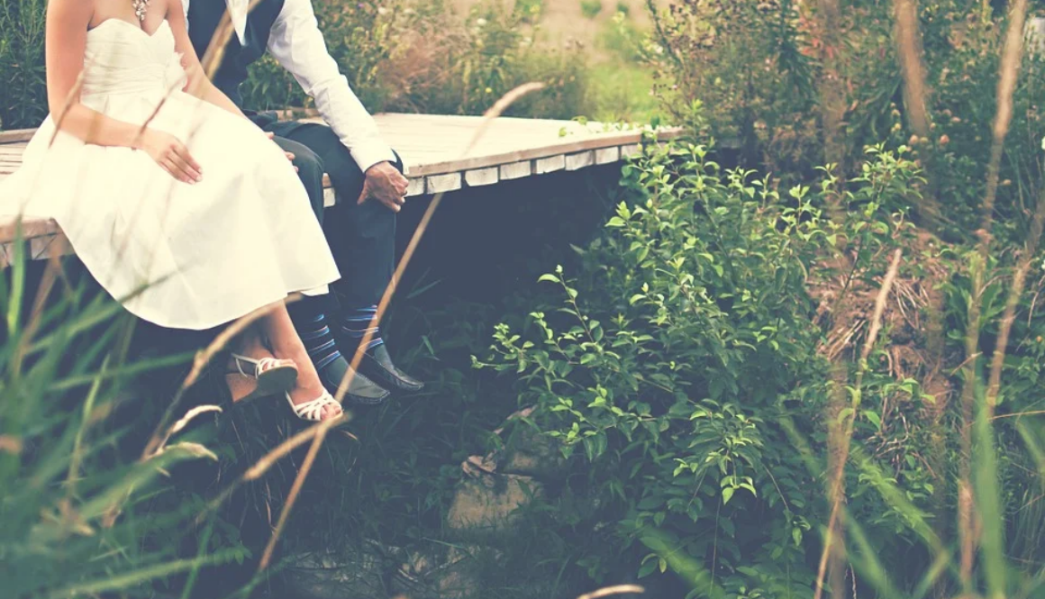 couple-sitting-on-dock